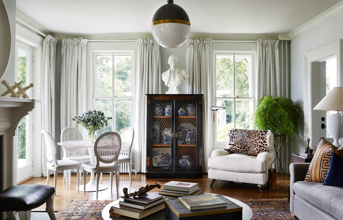 Hudson Valley Style / An eclectic combination of antiques and interesting objects enliven this lovely white parlor. A neoclassic bookshelf exhibits a collection of blue and white china.