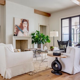 New Traditional Residence family room, original art anchors the room of natural textiles and white oak flooring.