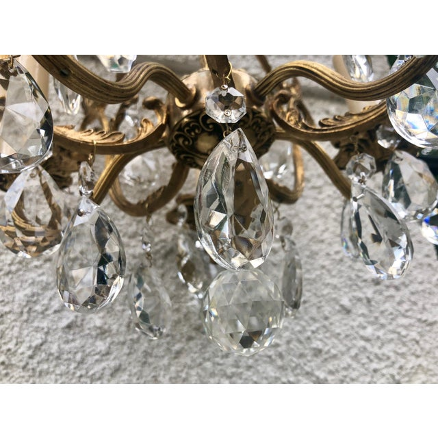 Scrolling lines and elegant details accent this antique French ormolu  chandelier. The piece dates back - 1920s Antique French Ormolu 5-Light Crystal Chandelier Chairish