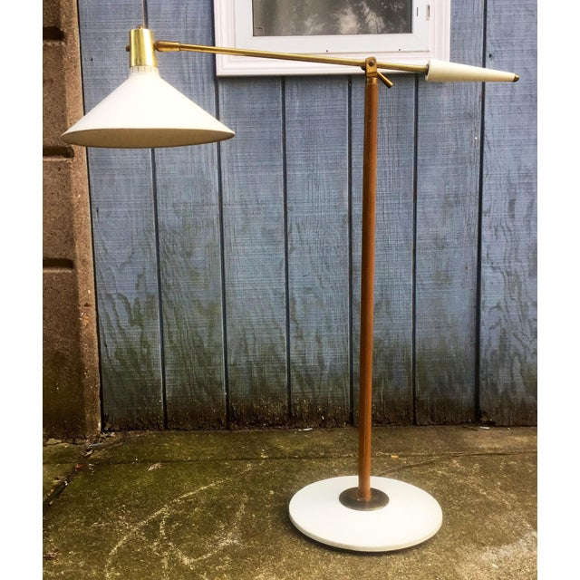 This listing is for a mid Century leather, brass, and painted Metal adjustable Floor Lamp. Condition-good overall...
