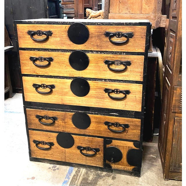 A Japanese Meiji period 2 section Kiri (paulownia) isho tansu, or clothing chest of drawers, from the late 19th century....