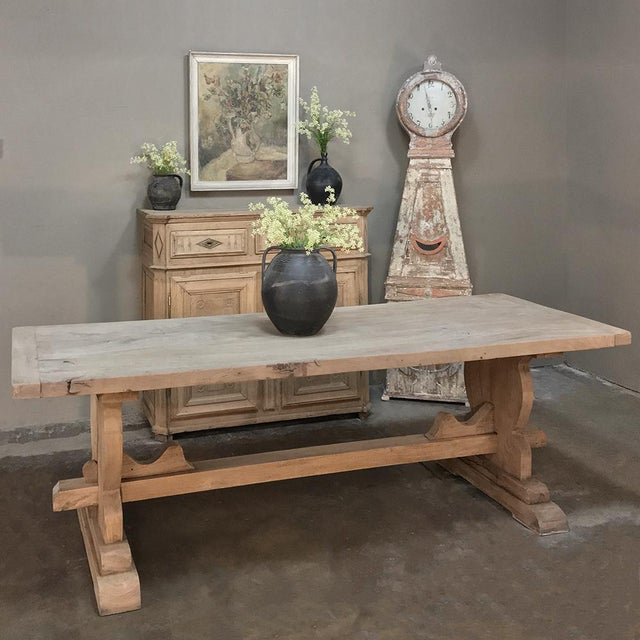 19th Century Country French Provincial Stripped Walnut Trestle Table reflects a bygone era when prized walnut was so...