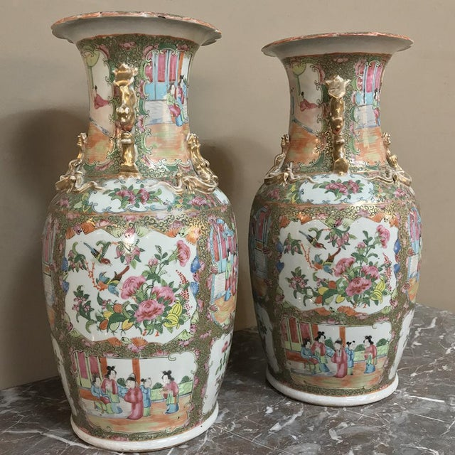 Pair 19th Century Hand-Painted Cantonese Rose Medallion Porcelain Vases feature amazing hand-painted detail with abundant...