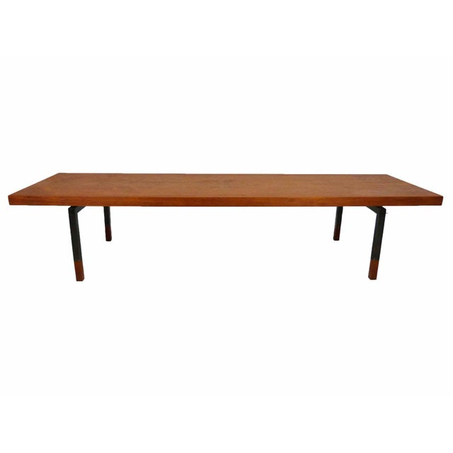 Circa 1960s industrial style Danish Modern teak coffee table with steel legs and solid teak sabots by Johannes Aasbjerg...