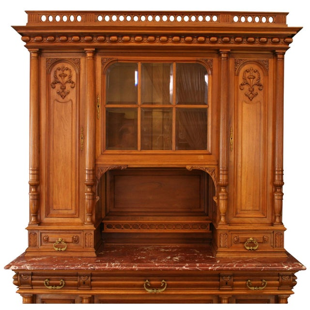 Offered is a stunning antique French buffet circa 1900. This elegant walnut piece features beautiful carved wood...