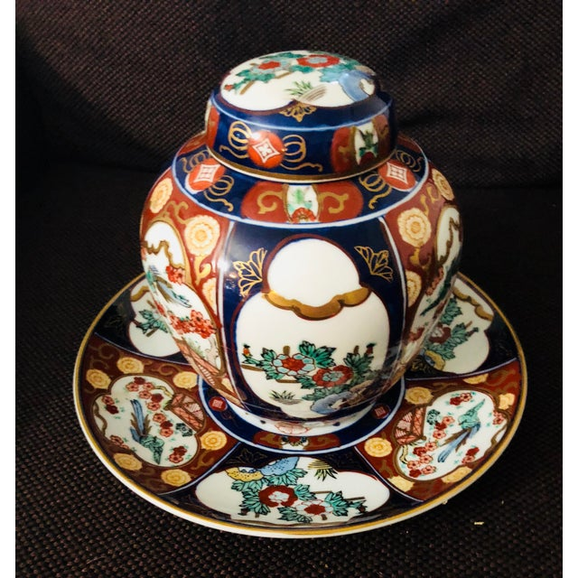 Gorgeous, vintage, hand-painted Imari ginger jar with lid and plate. Excellent condition, and the perfect touch to add to...
