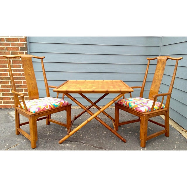 Gorgeous marriage of an easy-to-store folding faux bamboo table with woven reed top surface & a pair of Chinoiserie-style...