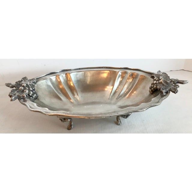 Love this Silver colored footed serving bowl with the Figural leaves and grapes handles! Think it may be Pewter.