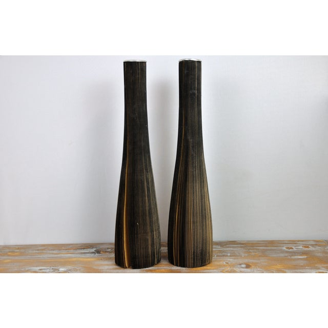 This is a pair of vases made from reclaimed craft paper. Minimalist and elegant in design. Make your flowers be the...