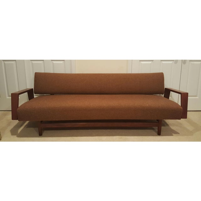 "Mid-Century ""Doublet"" sofa designed by Rob Parry for Gelderland in the 1950s. It has a solid teak frame and armrests which..."