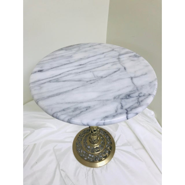 Lovely vintage petite side table made from marble and brass. Excellent piece for next to an accent chair in any room.