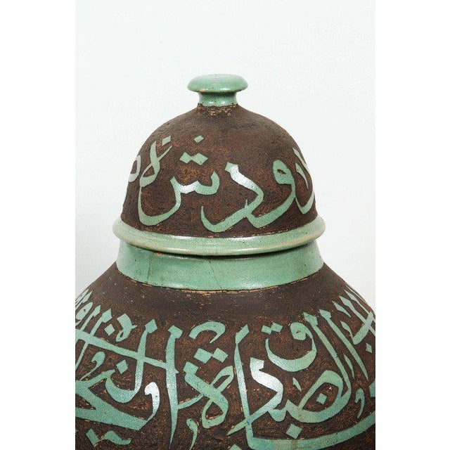 Large pair of Moroccan brown and green ceramic urns with lid, handcrafted in Fez Morocco, the green ceramic is hand-etched...