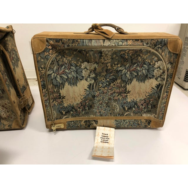 Vintage luggage set by French Luggage Company. Suede with beautiful tapestry canvassed outer. Very clean. Includes fold...