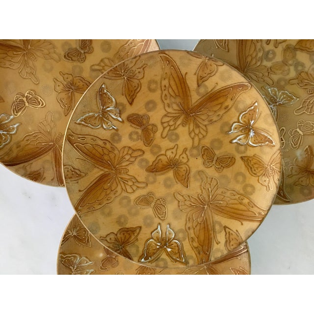 These bread and butter plates have a terrific gold and white outlined butterflies on a mustard background (DOT14). The are...