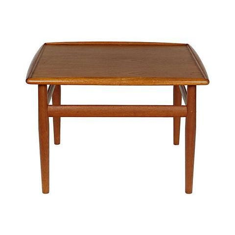 Mid-century modern 1960s Danish teak square side table with turned up sides. Refinished condition. No maker's mark.