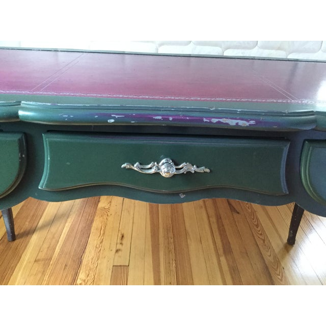 Stylish and distressed painted Louis XV style desk. This desk features an undercoat purple paint and a green finished...