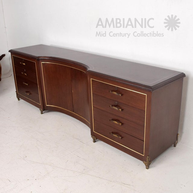 For your consideration a mahogany and bronze credenza. Unique design with curved doors and pull-out drawers on the sides....