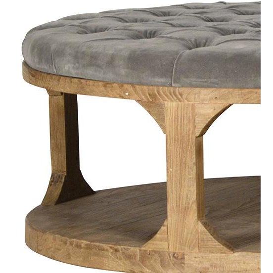 Grey tufted velvet upholstered round coffee table with a reclaimed elm wood frame. This chic, unique coffee table can...