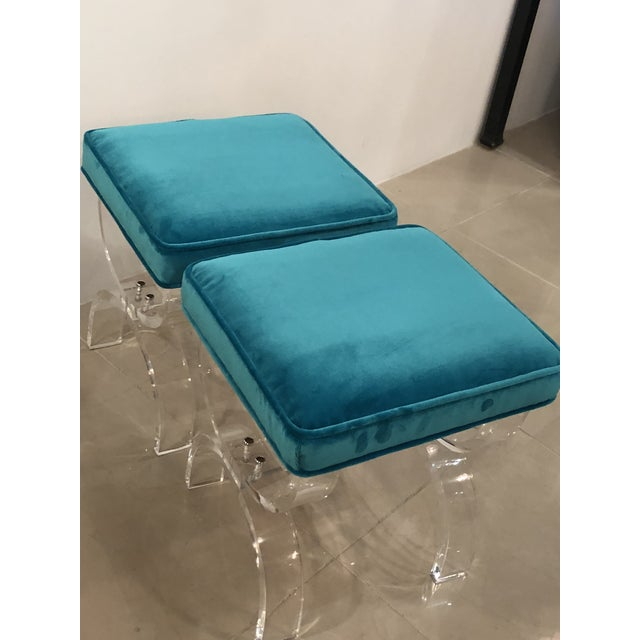 Professionally polished lucite pair x bench stools with new blue velvet upholstery. Meticulously restored.