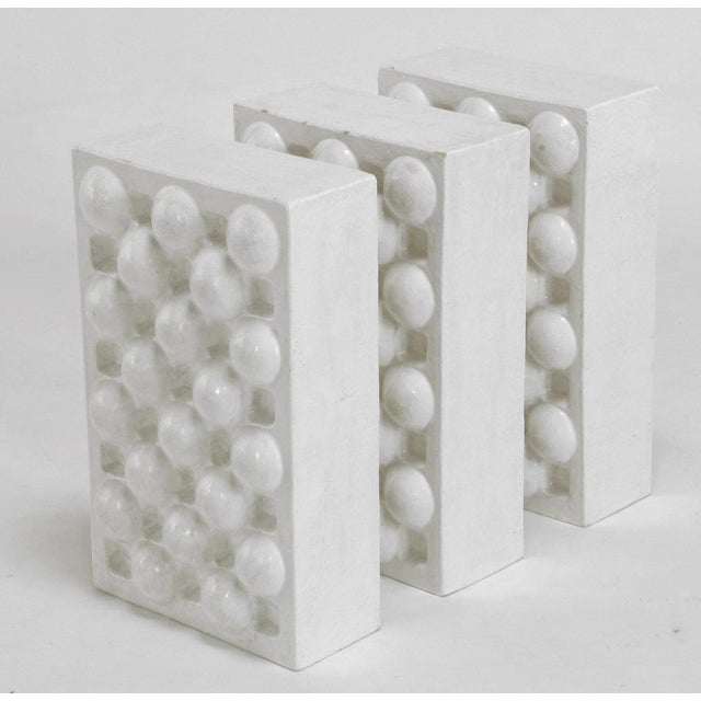 "Three white glazed ceramic ""crates"", by William August Hoffman (1920-2011), a ceramic sculptor and professor of ceramics..."
