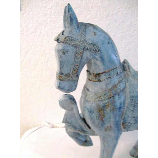Striking vintage generous size wood Tang design stallion stained a light blue with nailed brass embellishments.