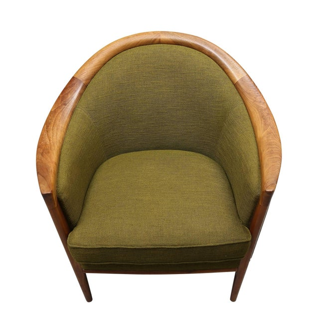 Comprising a sleek three-seat sofa and a matching armchair, the group is offered in its original, vintage green tweed...