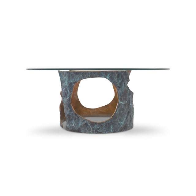 Solid bronze coffee table with round glass top by Willy Ceysens, made in Belgium. A unique and hand crafted piece from the...