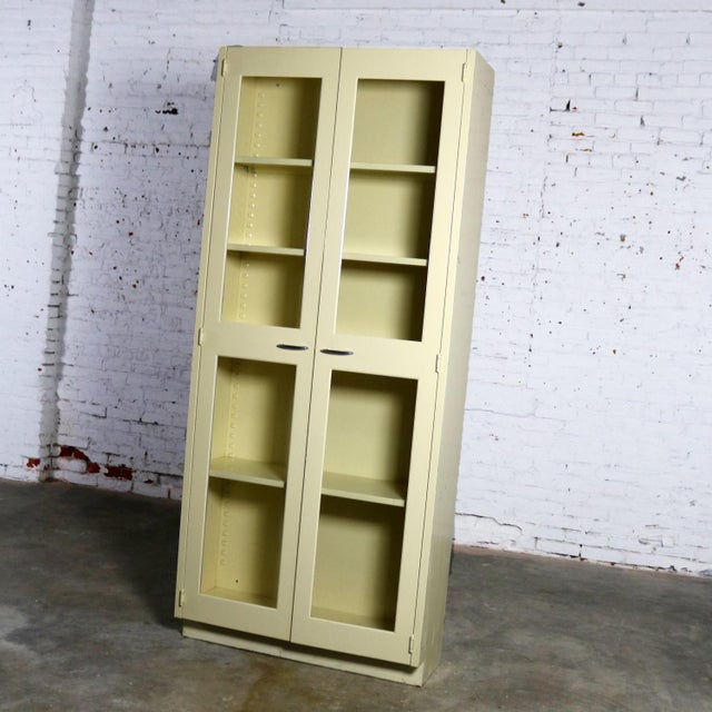 Handsome industrial metal display cabinet or bookcase with glass double opening doors. This awesome cabinet is in...