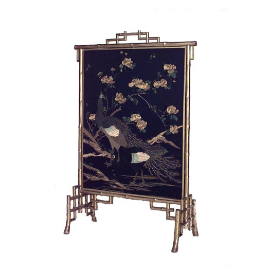 French Victorian gilt faux bamboo fire screen with blue floral and bird design panel painted chinoiserie decorations.