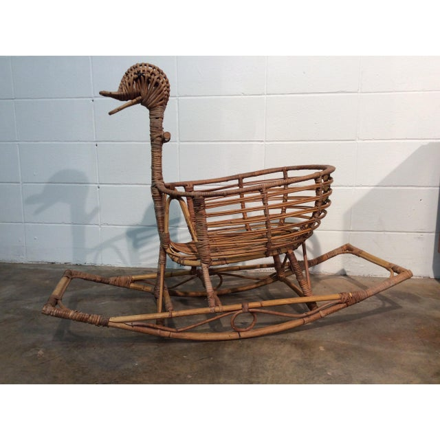 Adorable large duck rocking toy made of wicker and bamboo. Seating is comprised of 1 large basket w 2 frontal leg...