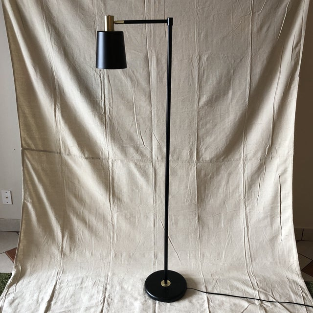 Mid-Century Style Articulated Arm Brass and Black Floor Lamp, black round marble base. Floor on/off switch 21st Century...