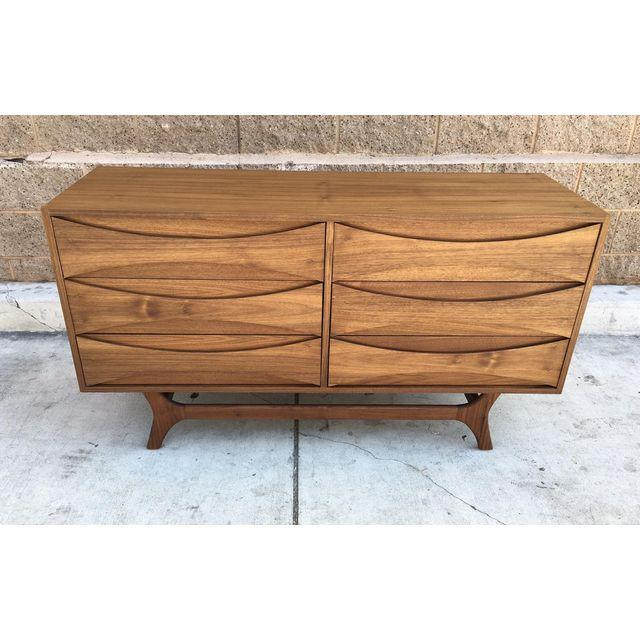 A gorgeous, custom Mid-century Danish Modern-style dresser. Crafted of both solid and veneer walnut, this dresser features...