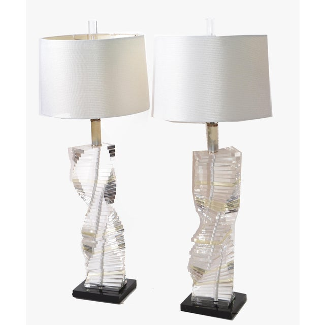 Superb pair of Lucite lamps, black Lucite base and spriral stacked staircase design of clear Lucite. US wired and each...