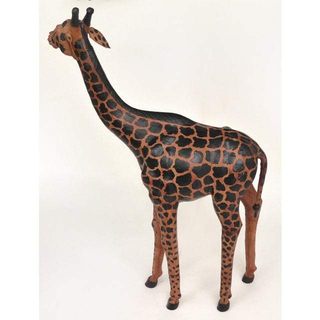 Offered for sale is an over-scale over 4 foot tall leather Giraffe sculpture with Glass Eyes. The leather is painted with...