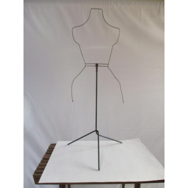 "Modernist form fluid metal dress hanger art sculpture. Measure about 40"" tall In excellent vintage condition. We think it..."
