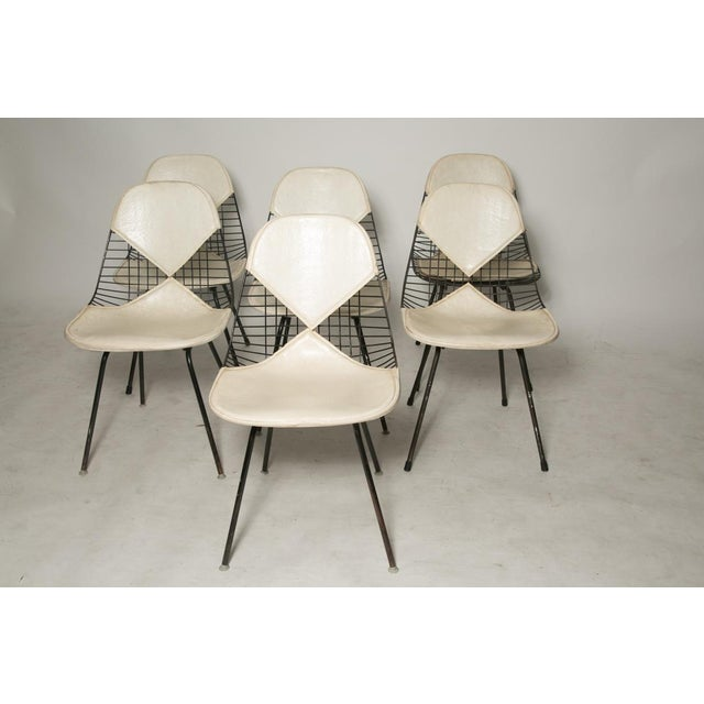 Original and unrestored Eames for Herman Miller DKR-2 chairs with white bikini pads on black H-bases. Some chairs have...