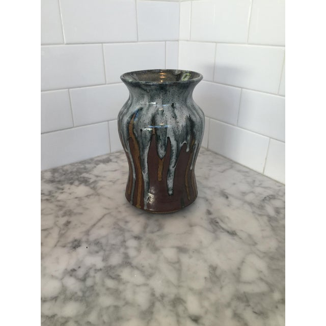 Beautiful piece of pottery. This vase is multicolored with gray, black, brown, reddish brown colors. Thick glaze inside...