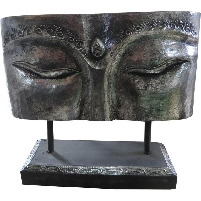 This silver face panel on a stand was made in Indonesia.