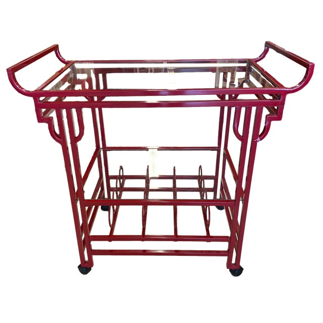 Bright red bar cart. Sort of Art Deco, sort of Chinoiserie, sort of 70's Mod and all gorgeous. The symmetrical design has...