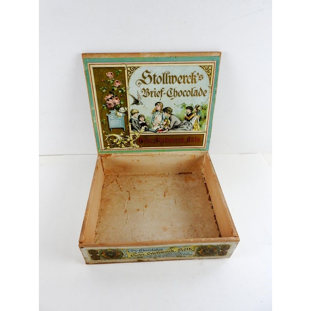 Circa late 1800's German Stollwerck's Chocolate store display box. Great lithograph paper covering over wood. Some fading...
