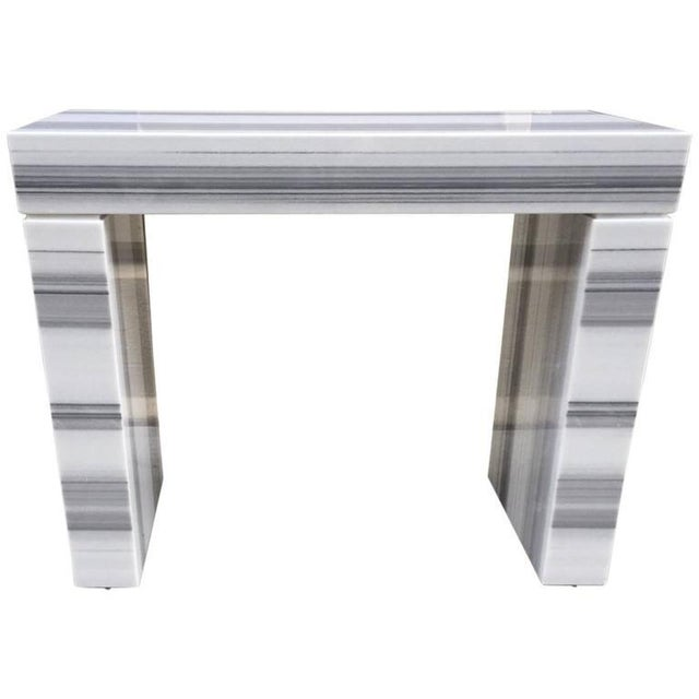 Carrara marble console / fireplace mantel in three parts. Nice shades of gray.