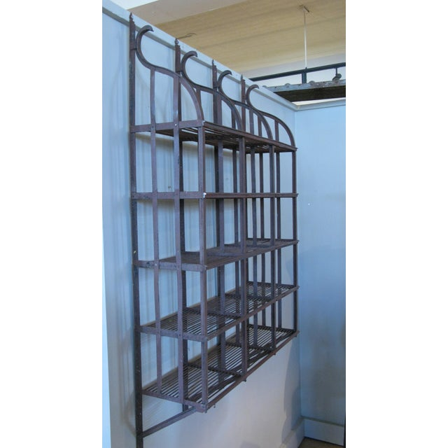 A beautiful vintage 1950s wrought iron wall-mounted hanging shelving rack, with curved top and five shelves. Perfect for...