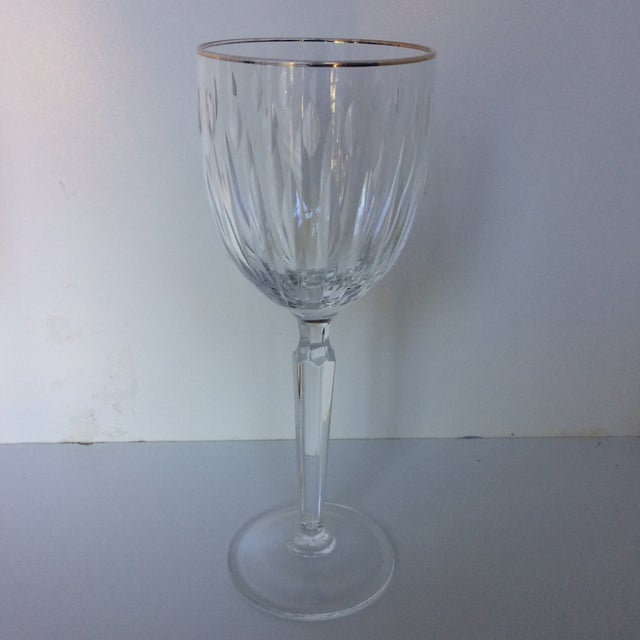 I am not sure of the manufacturer but these crystal wine glasses scream high end by the way that they feel and balance in...