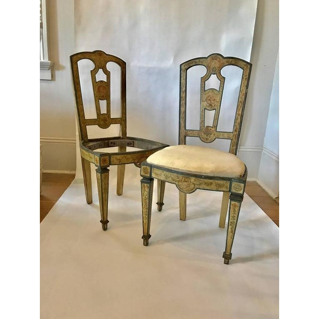 Four 18th century Italian side chairs with exceptional painted decoration; highly detailed garlands, rosettes, and flower...