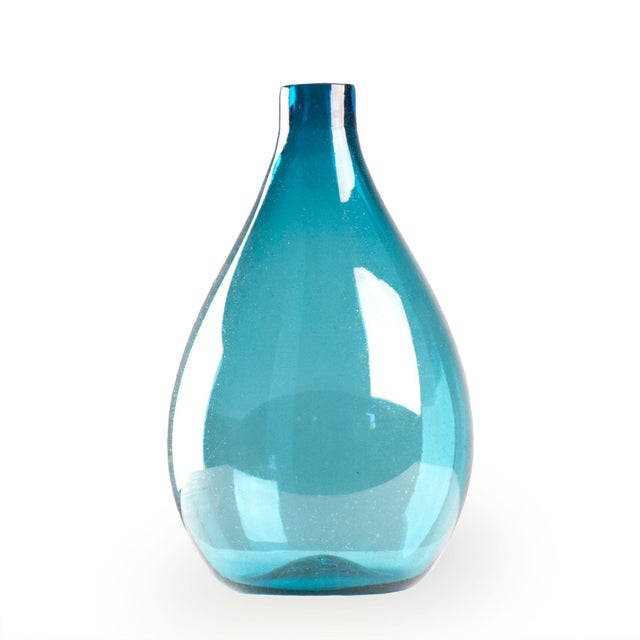 Large blue tear drop shaped glass vase.