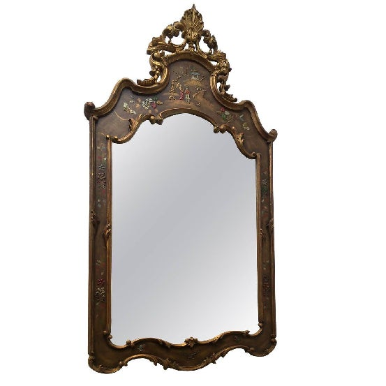 This is a beautiful ornately carved and gilded decorated wood mirror done in the Chinese style hand carved and enameled...