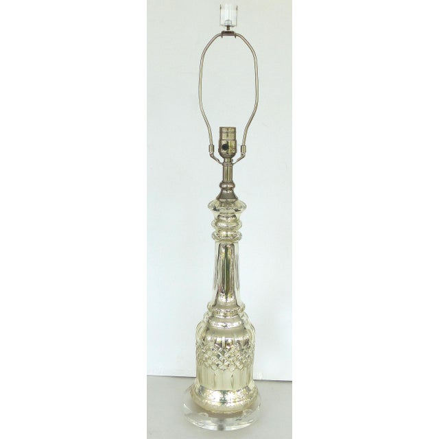 Offered for sale is a pair of mercury glass tables lamps with lucite bases and finials. Both lamps have been updated with...