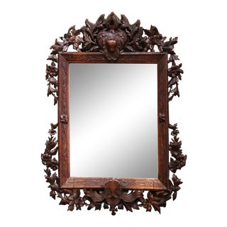 19th Century French Black Forest Carved Walnut Wall Mirror With Foliage Motifs For Sale