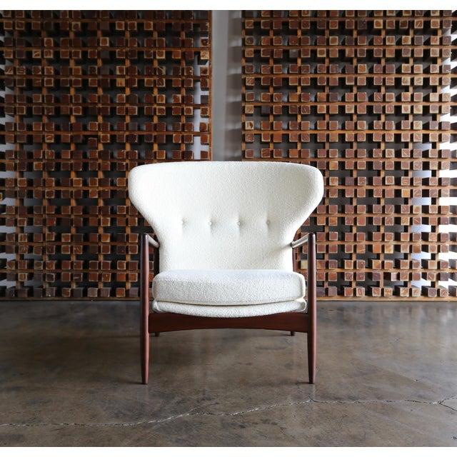 Ib Kofod-Larsen wingback lounge for Selig, circa 1965. This piece has been professionally restored. Upholstered in holly...