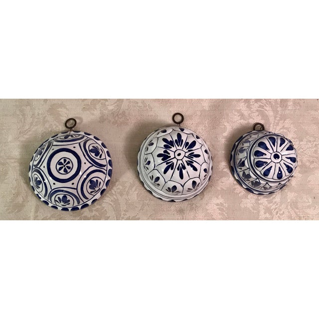 Nice set of three vintage decorative blue and white molds. Hanging rings attached with wire to each. Really nice set!